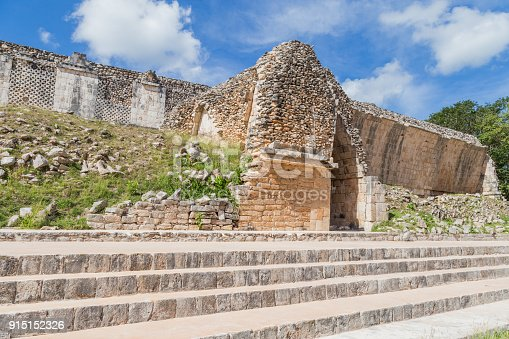 istock Ancient city in the jungle. Mayan temple Uxmal archeological site, ruins in Yucatan. Pyramid of the Magician (Piramide del adivino) in ancient Mayan city Uxmal, Mexico 915152326