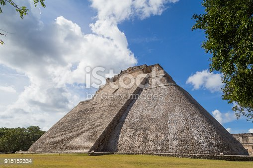istock Ancient city in the jungle. Mayan temple Uxmal archeological site, ruins in Yucatan. Pyramid of the Magician (Piramide del adivino) in ancient Mayan city Uxmal, Mexico 915152334