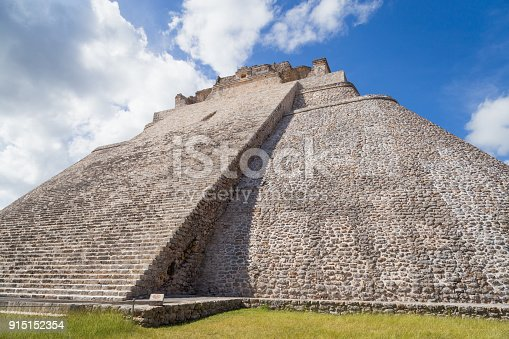 istock Ancient city in the jungle. Mayan temple Uxmal archeological site, ruins in Yucatan. Pyramid of the Magician (Piramide del adivino) in ancient Mayan city Uxmal, Mexico 915152354