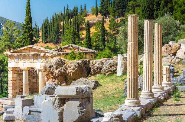 Ancient city of Delphi with ruins of the temple of Apollo, the omfalos (center) of the earth, theater, arena and other buildings, Greece stock photo