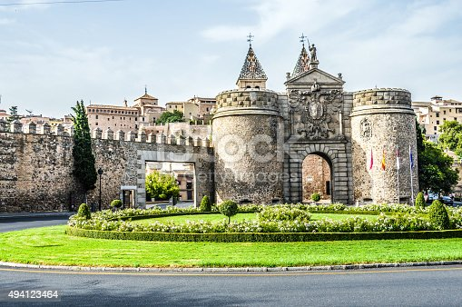 Ancient city walls and gate on approach to Toledo, Spain seen as one enters the town.