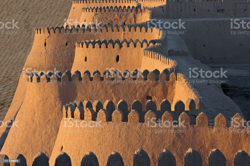 Ancient city walls of the old town of Khiva in Uzbekistan. stock photo