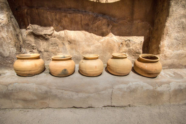 Ancient Clay Pots In Row Outside An Adobe stock photo