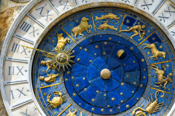 Ancient clock in the St. Mark's Square in Venice Ancient clock (Torre dell'Orologio) in the St. Mark's Square in Venice, Italy. Detail with ckock face and Zodiac signs. astronomical clock stock pictures, royalty-free photos & images