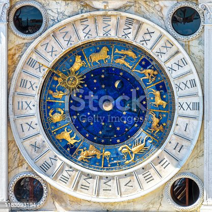 Ancient clock Torre dell'Orologio with Zodiac signs, Venice, Italy. It is old landmark of Venice. Medieval mechanism with vintage symbols of astrology on star circle. Concept of horoscope and time.