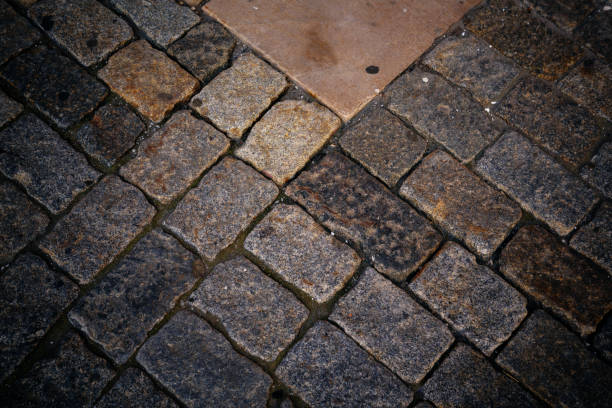 ancient cobblestone pavement - granite rock stock photos and pictures