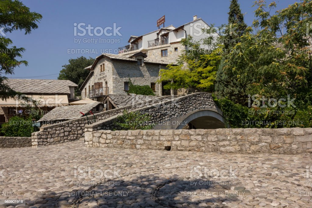 Ancient cobblestone square in Mostar near an old stone bridge - Royalty-free Ancient Stock Photo
