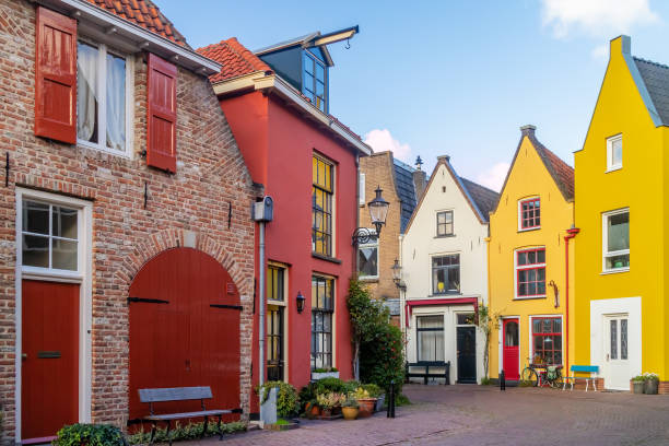 Ancient colorful houses in the famous Dutch Walstraat street in Deventer stock photo