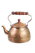 ancient copper Moroccan tea pot on white background