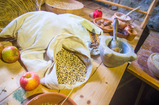 ancient country cuisine, traditional cuisine, ingredients, agricultural and hunting products, sorghum, facioli, chickpeas, pomegranate, apple, pestle, pesto, marble stock photo