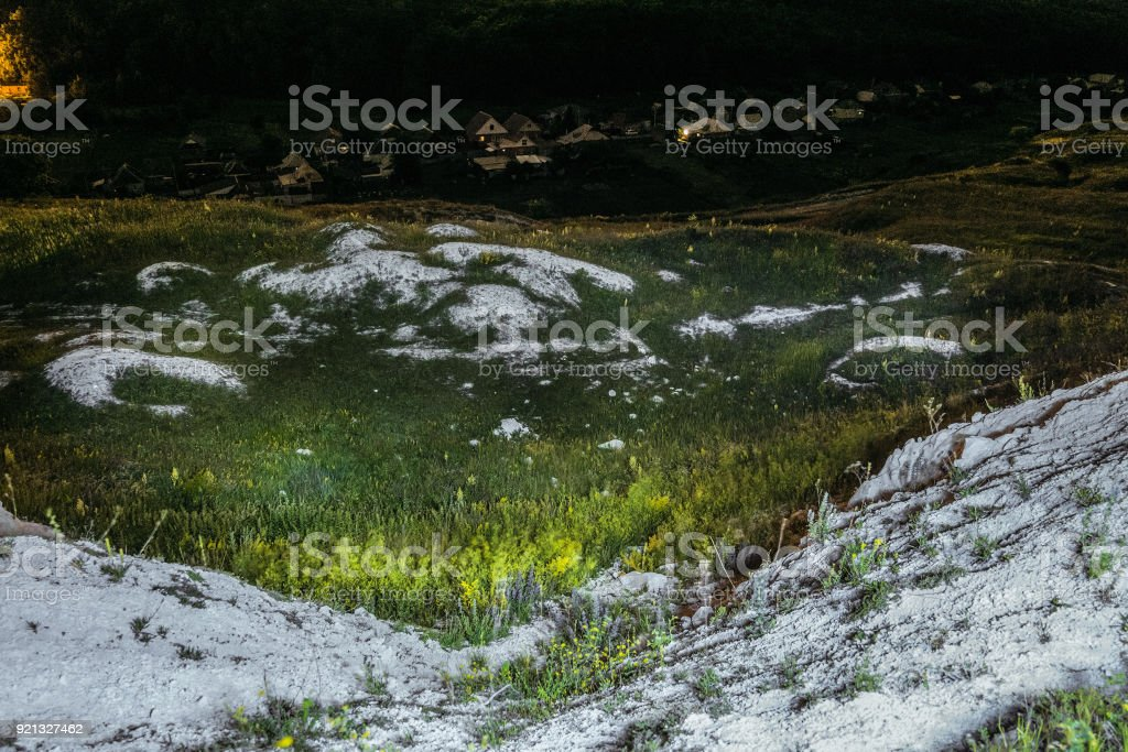 Ancient Cretaceous overgrown ravine with outcrops of chalk. Night landscape. Krapivnoe village. Territory natural archaeological monument - Krapivenskoye ancient settlement, Belgorod region, Russia. stock photo