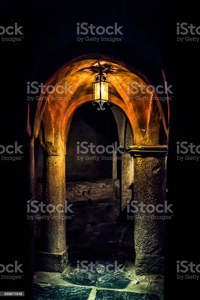ancient crypt lit by a lantern stock photo