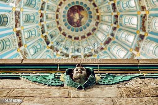 Ancient sculpture of an angel with open wings on the Dome interior of the Ressurection Cathedral of the russian New Jerusalem monastery background