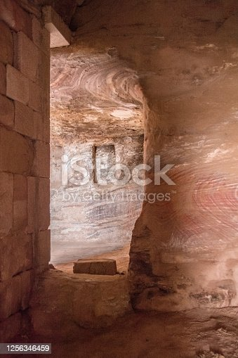 Ancient curved cave indoors, Architecture Built in red rock, desert