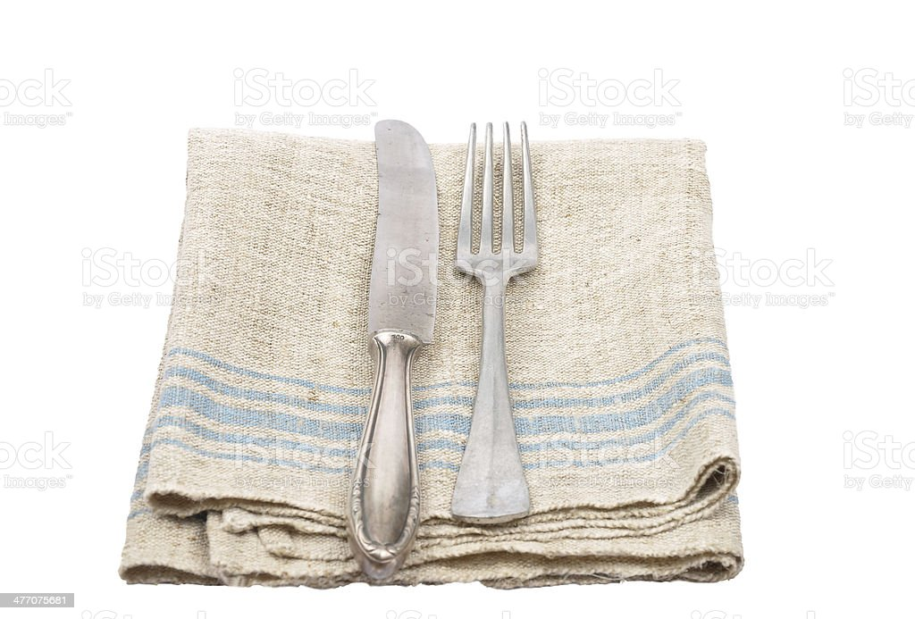 Ancient cutlery on linen royalty-free stock photo