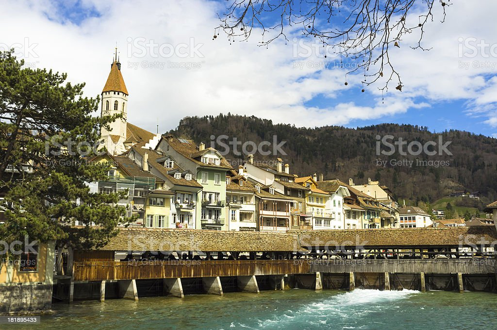 Ancient dam and wooden bridge in Thun, Switzerland royalty-free stock photo