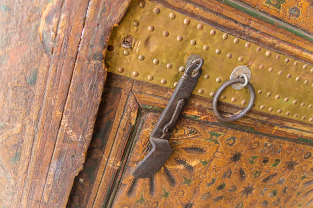 Ancient door and locking mechanism with Islamic decoration stock photo