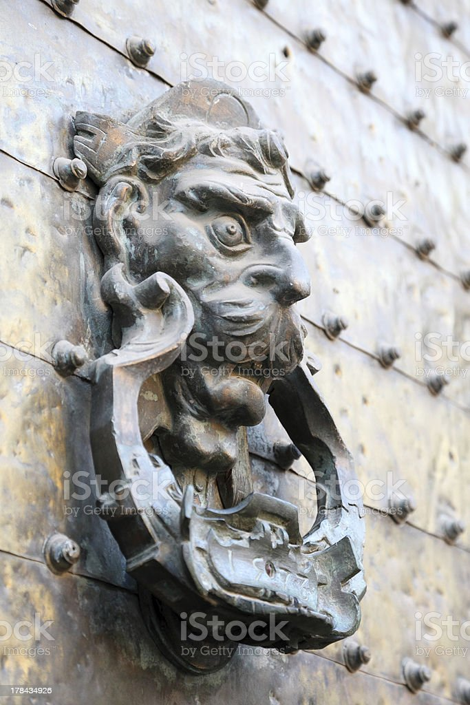 Ancient door knocker royalty-free stock photo