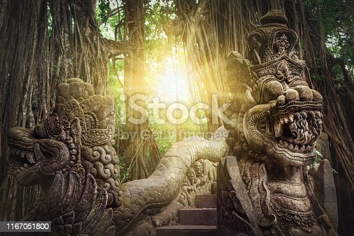 Ancient dragon sculptures on the bridge in monkey forest, Ubud, Bali, Indonesia