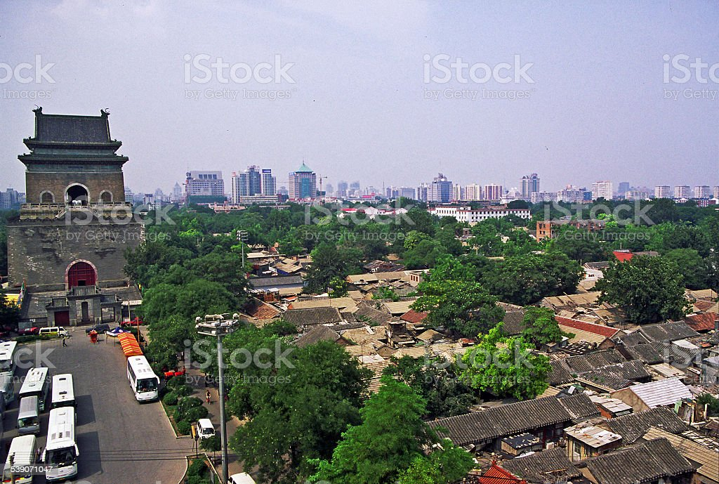 ancient drum Tower with modern Beijing in background, China stock photo