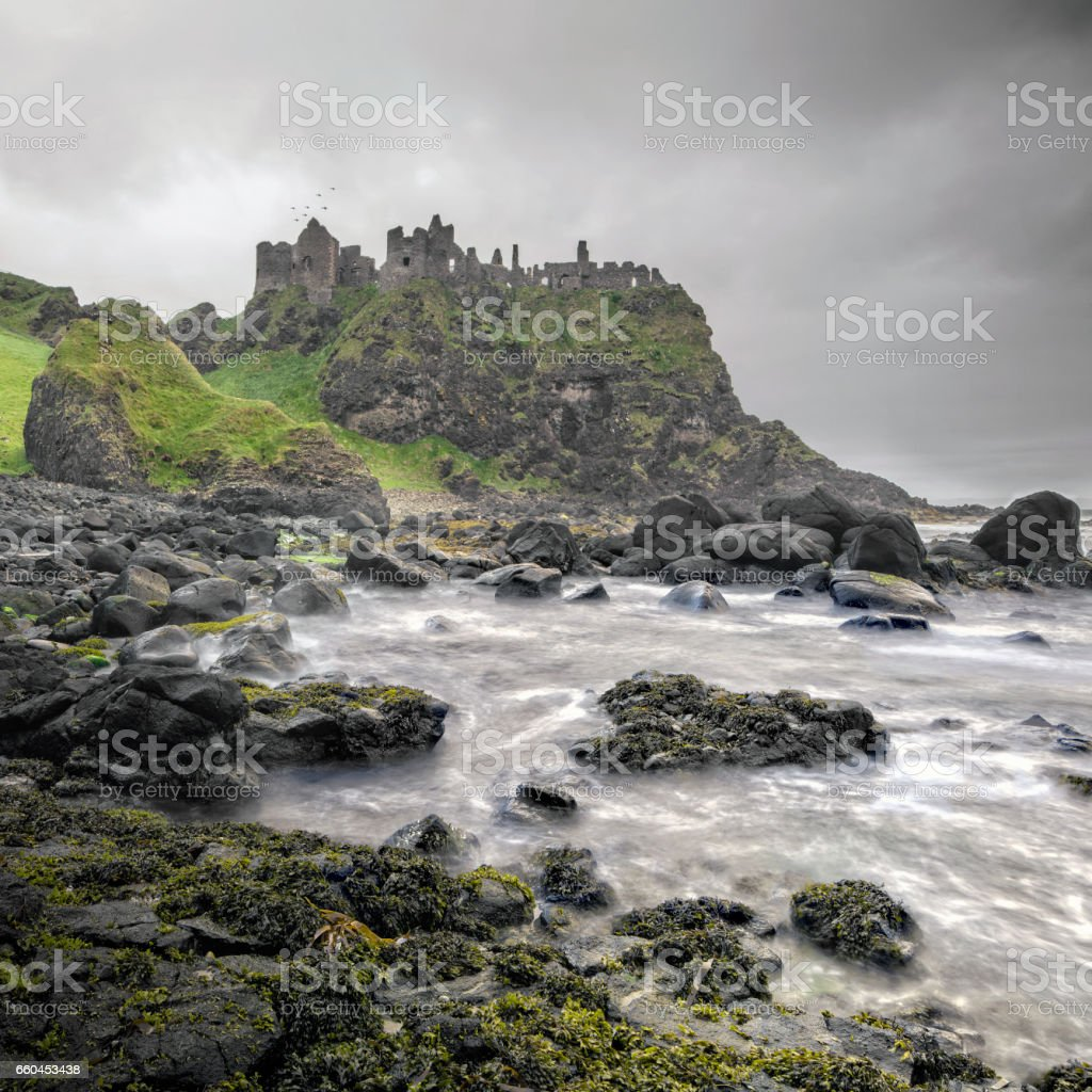 Ancient Dunluce Castle on a cliff, Ireland stock photo