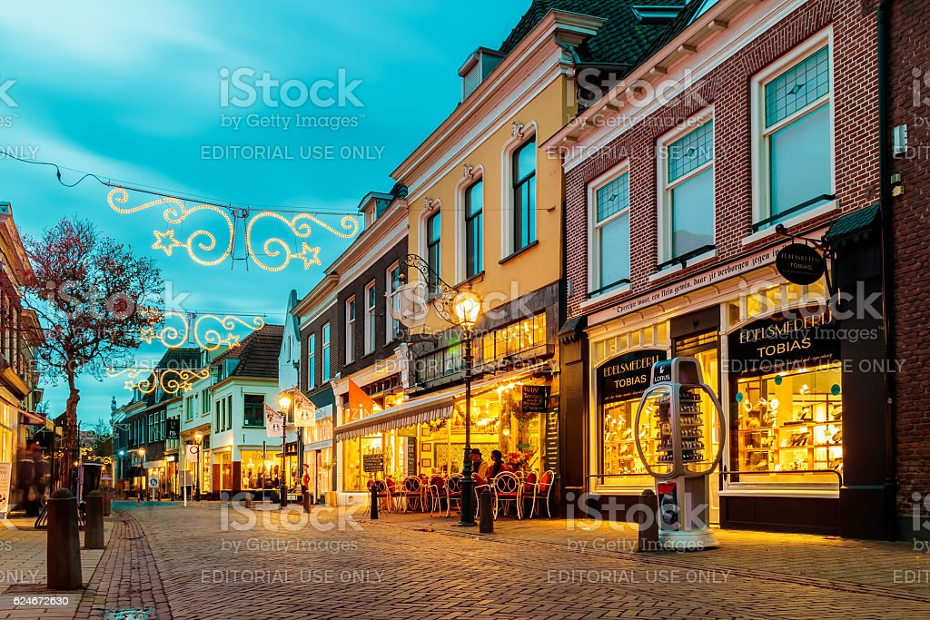 Ancient Dutch shopping street with christmas decoration stock photo