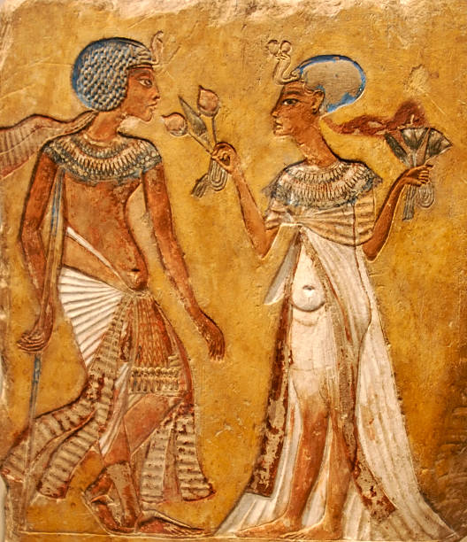 Ancient Egyptian wall painting of a couple stock photo
