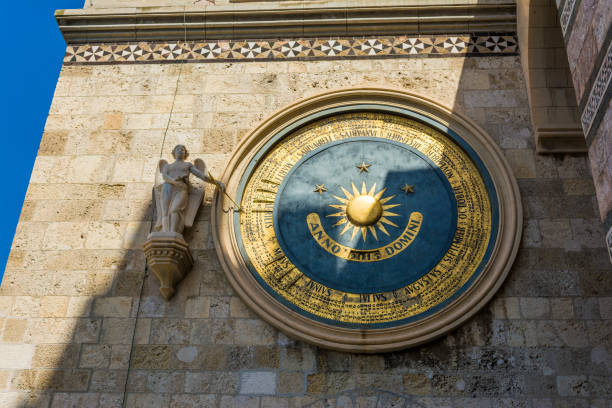Ancient eternal cathedral clock and calendar in Messina. Sicily stock photo
