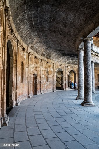 istock Ancient Euopean Corridor With Rounded Pillars And Arches 692814392