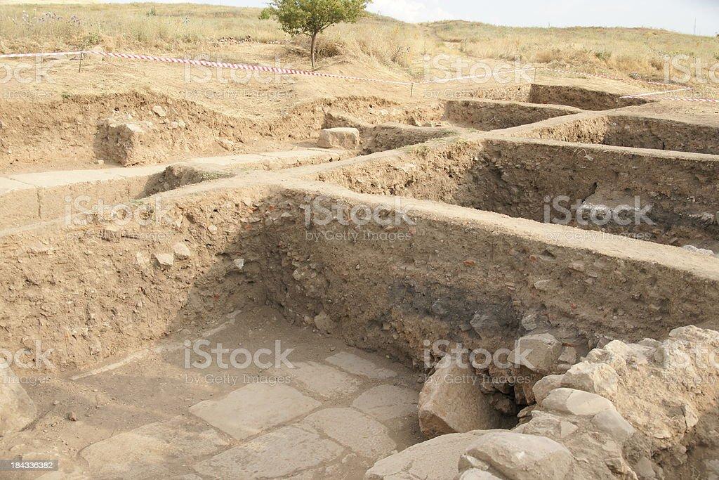 ancient excavation site stock photo
