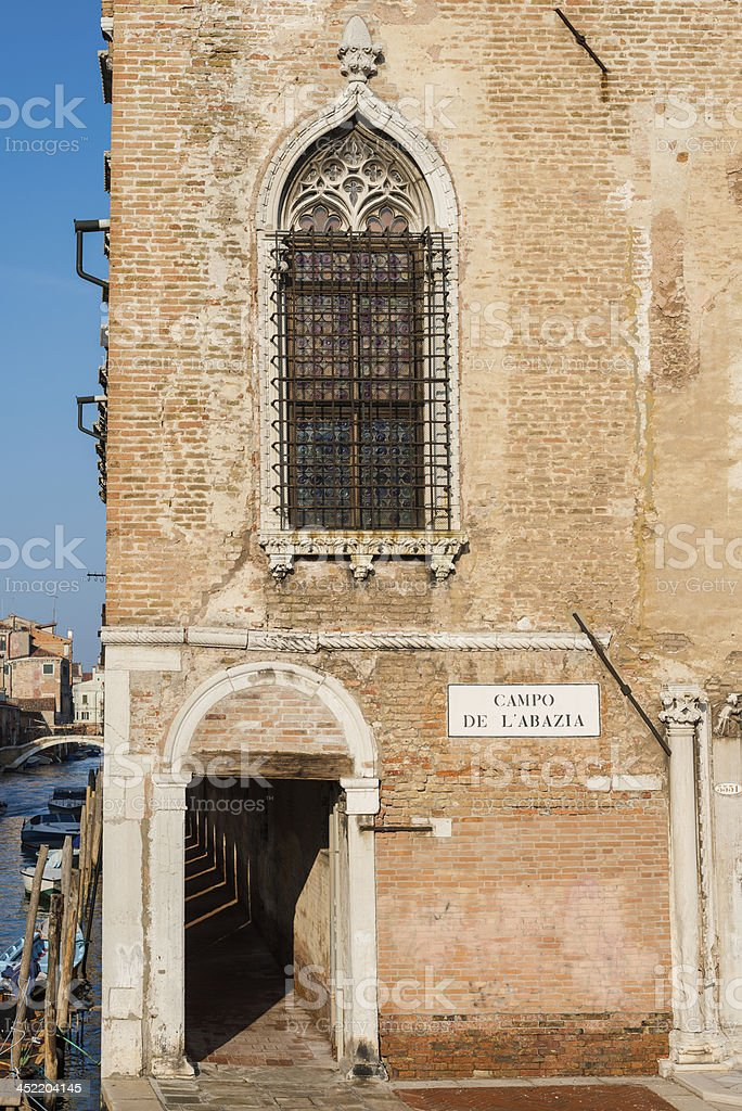 Ancient facade of a building in Venice, Italy royalty-free stock photo