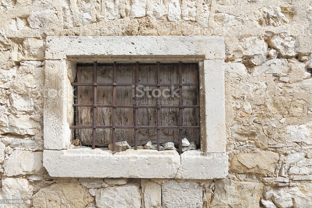 ancient facade with closed prison window Zadar Croatia royalty-free stock photo