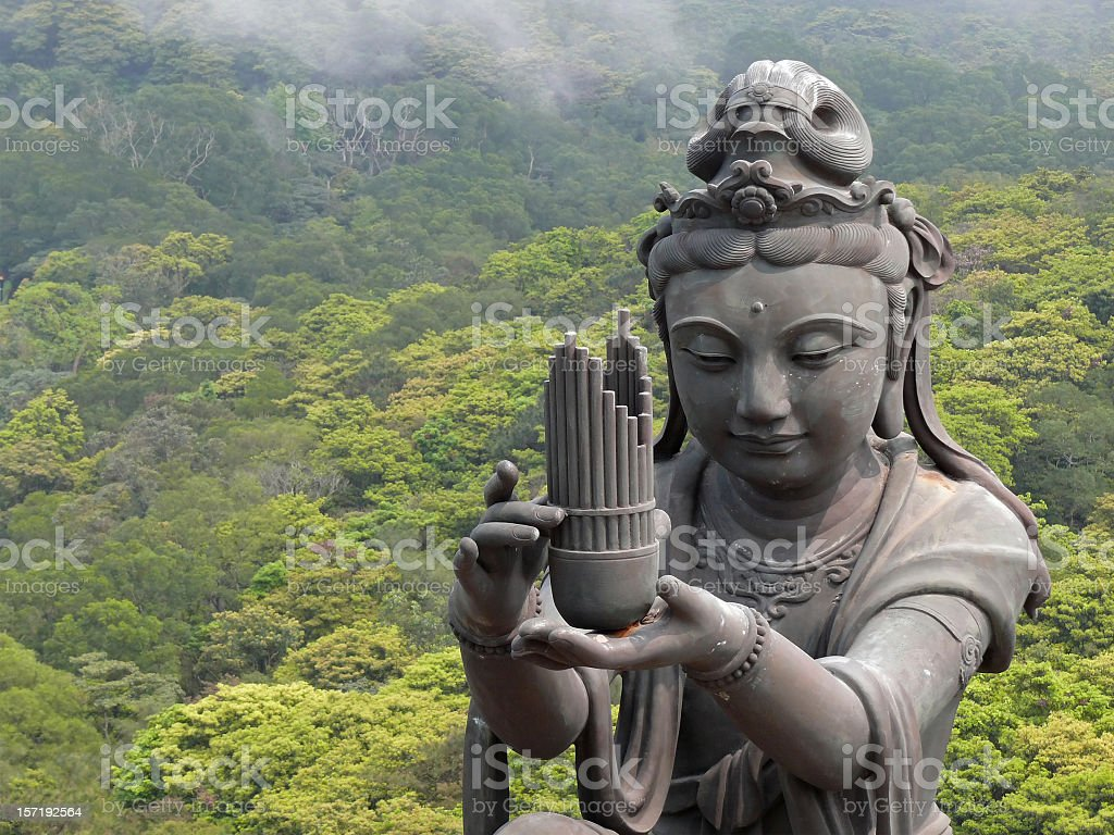Ancient female temple statue with offering stock photo