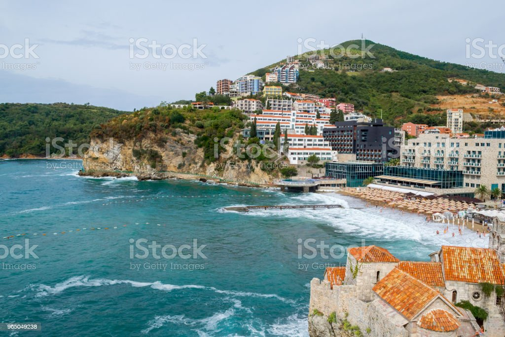 Ancient fortress and modern buildings on the coast. Budva. Montenegro, Europe. royalty-free stock photo