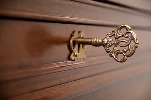 Ancient furniture lock, decorated key.