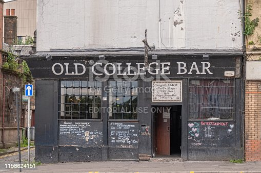 Glasgow, Scotland, UK - June 22, 2019: The old College Bar thought to be the oldest pub in Glasgow in need of some fresh paint.