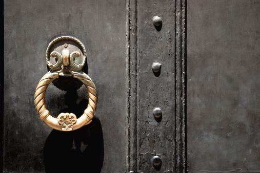 Ancient Golden Door Handle of Castle on Black Background