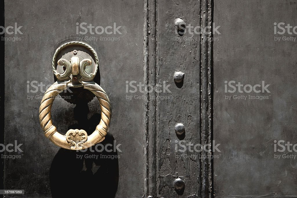 Ancient Golden Door Handle of Castle on Black Background stock photo