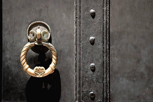 Ancient Golden Door Handle of Castle on Black Background stock photo