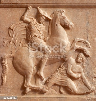 Ancient Greek bas-relief on funerary stele from Kerameikos Ancient Cemetery in Athens, Greece. Its depicting battle scene between a rider, the deceased, and a fallen hoplite, a heavily armed foot soldier of ancient Greece.