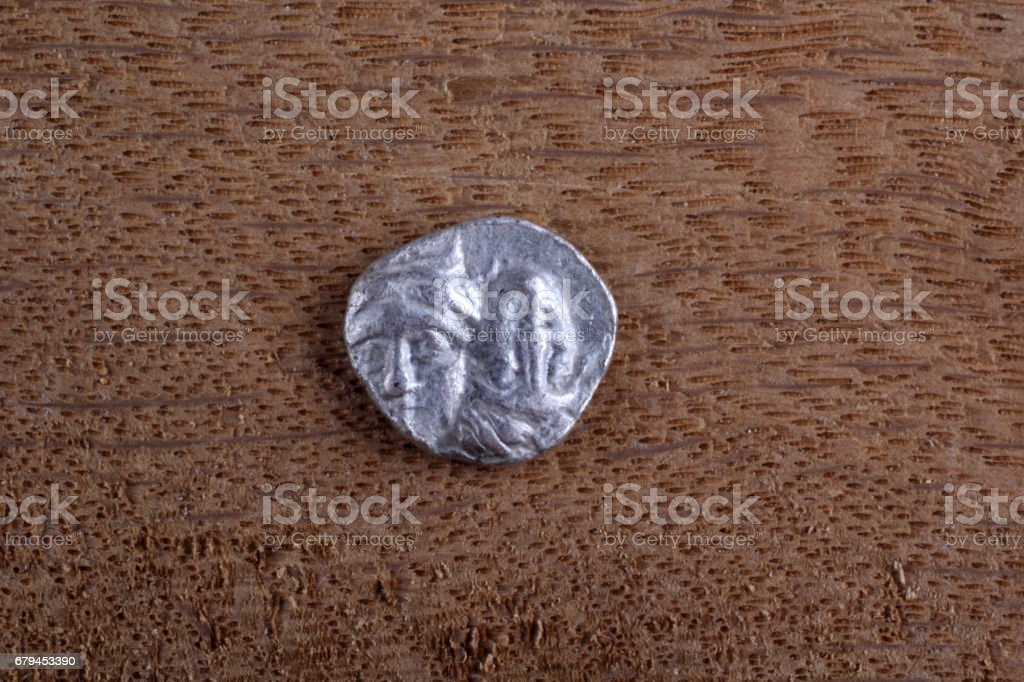 Ancient Greek coin. Twins royalty-free stock photo
