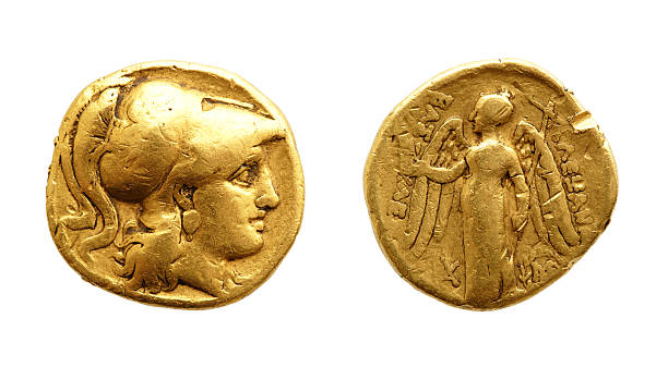 Ancient greek gold coin The two sides of an ancient gold coin isolated on white. antediluvian stock pictures, royalty-free photos & images