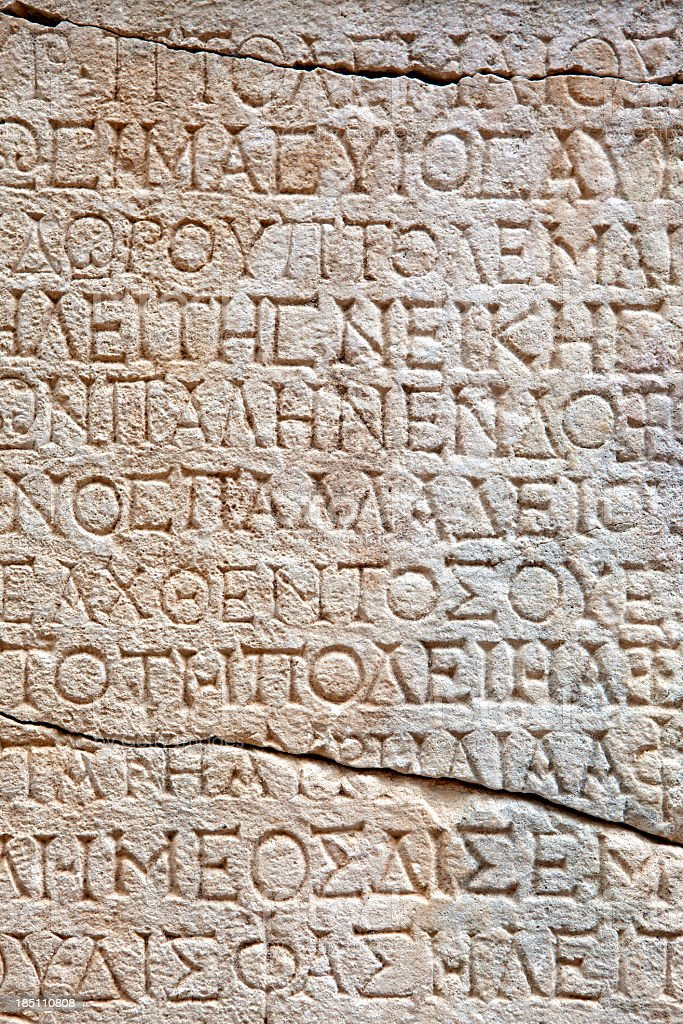 Ancient Greek Inscription on Stone Wall in City of Phaselis stock photo