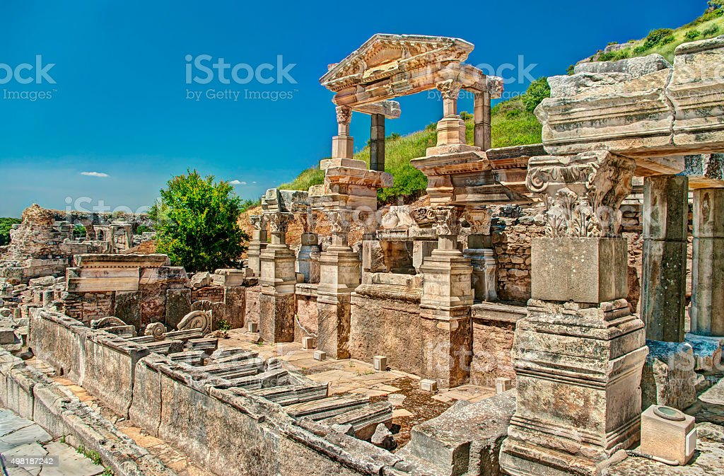 ancient greek ruins against clear blue sky stock photo
