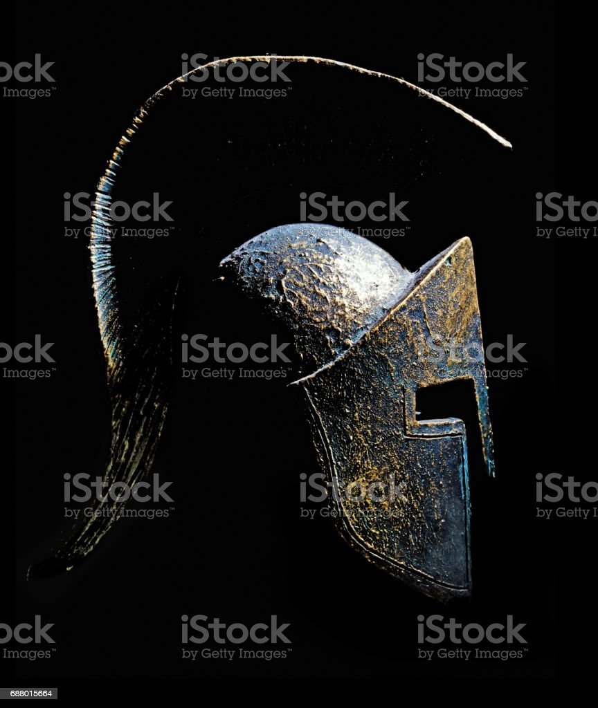 Ancient greek Sparta type helmet isolated on a black background stock photo