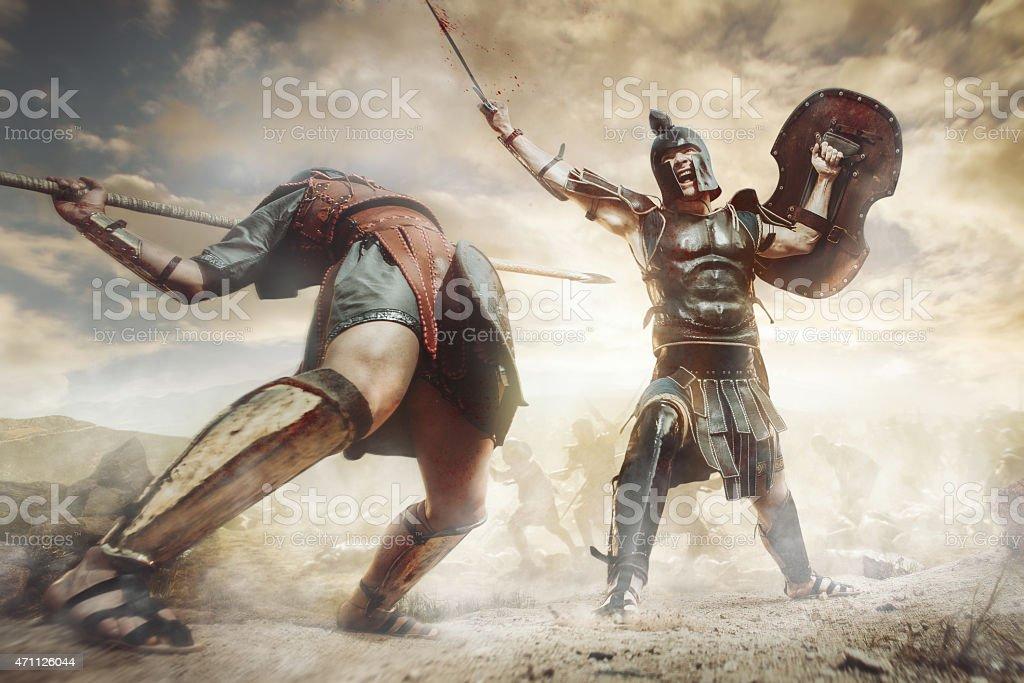 Ancient Greek warrior fighting in the combat stock photo