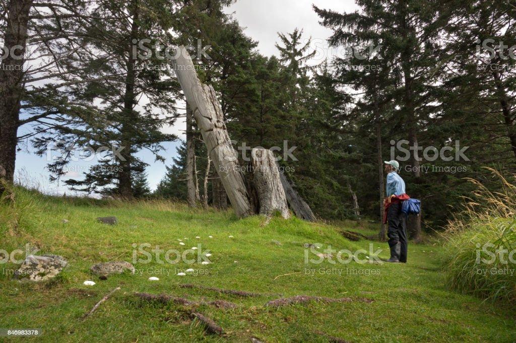 Ancient Haida Skedans village totem poles Haida Gwaii British Columbia Canada stock photo