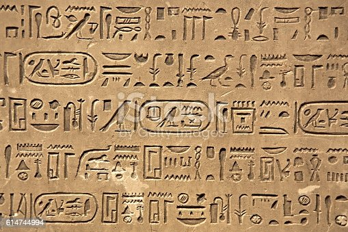 istock Ancient Hieroglyphic Script 614744994