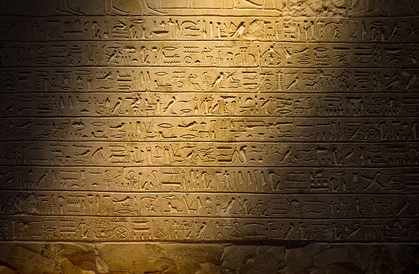 ancient hieroglyphics dimly lit - dimly stock pictures, royalty-free photos & images