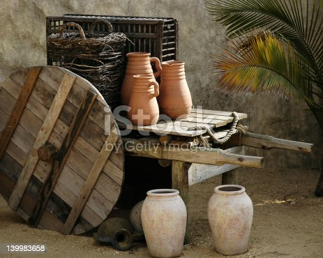 Pottery and wooden ware depicting ancient mid-eastern domestic life.
